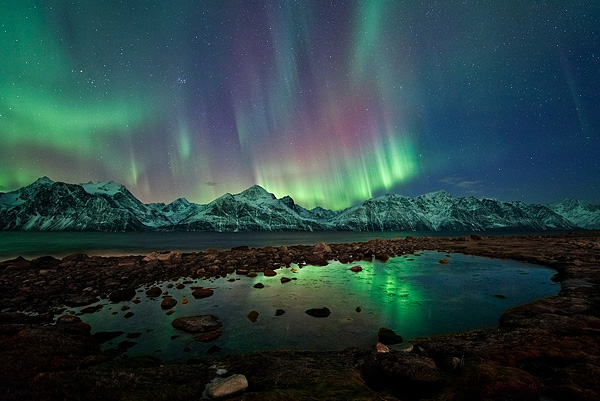 To watch the most beautiful natural phenomenon with the loved one in the icy darkness of Norway